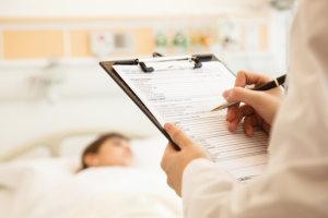 nurse monitoring the patient's condition